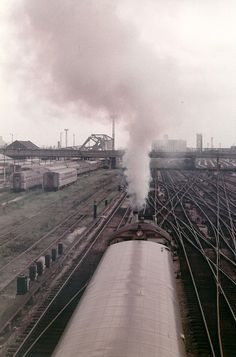 https://flic.kr/p/dT4mt8 | Smoking can be harmful to your health. | i.e. don't stand on a bridge as a Santa fe Alco switcher trundles under you. Shot from the 18th Street bridge in Chicago in September 1975.