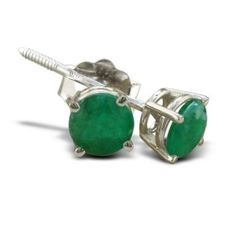 The emeralds in these earrings have been oiled to make the stones' inclusions less visible.