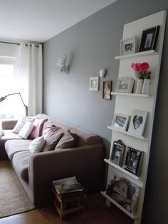 I like this shelving idea. I've lived in my home for 5 years now and I'm still afraid to hang anything on the walls. Leaning works for me. :)