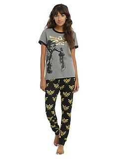 """<div>If you're gonna spend the whole weekend playing <i>The Legend Of Zelda</i>, you should probably be wearing something comfortable. This sleep set is perfect! The heather grey ringer tee has an image of Link on front with a gold foil Triforce symbol. The black joggers have an elastic and drawstring waistband, black elastic cuffs and an allover Triforce print.</div><div><ul><li style=""""LIST-STYLE-POSITION: outside !important; LIST-STYLE-TYPE: disc !important"""">Top: 60% cotton; 40% poly..."""