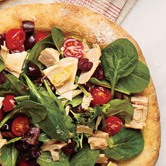 Tuna Salad Pizza combines the best of both. Flaky albacore tuna is layered over mixed salad greens, kalamata olives, and grape tomatoes--all topped with freshly shaved Parmesan cheese.