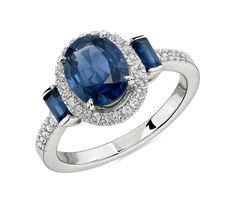 Elegantly charming, this three stone ring features vibrant sapphires framed by halos of white sapphires in a detailed setting crafted of white gold. Turquoise Diamond Rings, Blue Sapphire Rings, Top Engagement Rings, White Gold Rings, Wedding Rings, Baguette, Blue Nile, Vibrant, Stone