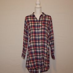 Plaid long button up Red, white and blue long button up. Has slits on the slide. Comfy and cute. You can dress this up or down. Forever 21 Tops Button Down Shirts