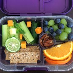 Reboot your system with this delicious detox Yumbox lunch. This is vitamin and energy packed little box that will refresh you and satiate your afternoon appetite. In this Figue Purple Yumbox Panino we have cucumber spears, rye crackers, cheddar cubes, grapes, blueberries, orange slices and pecans. Eat light. Eat fresh. Yumbox makes healthy eating a breeze.