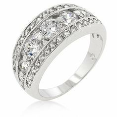 White Gold Rhodium Bonded Seven-stone Anniversary Style Ring trimmed with Pave CZ in Silvertone . $23.38