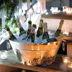 can't go wrong with a silver bucket full of champagne