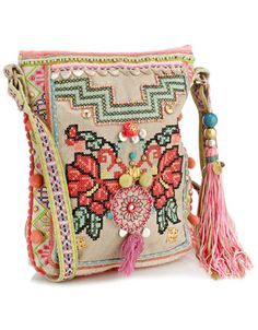 Unique embellished cross body with neon embroidery, pattern shoulder strap, pom poms and large tassel charm.