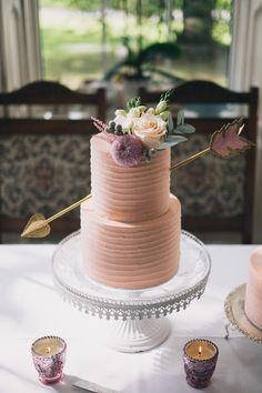 Whimsical arrow soft iced pink wedding cake | swap soft pink for soft lavender  www.onefabday.com