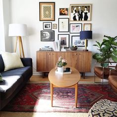 Living Room:Midcentury Modern Living Room With Oval Table On Persian Rug Also Retro Wall Arts Things to Consider When Making Mid Century Modern Living Room Designs