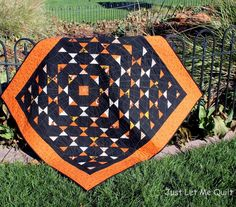 Halloween quilt at Just Let Me Quilt.  Spiderweb quilting with glitter thread. Tag Team quilt pattern by Missouri Star quilt Co.