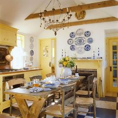 Welcoming yellow kitchen w/black & white floor in Nantucket cottage. Gary McBournie
