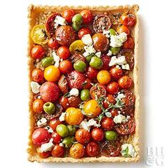 This buttery tart is topped with fresh tomatoes, goat cheese, and olives. Top the finished slab with fresh oregano and black pepper.