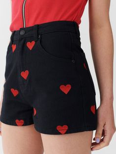 """High-rise shorts in black denim All-over direct embroidered heart motifs Hip curve pockets Zipper and button fly opening Back patch pockets Lazy Oaf embossed hardware Gentle machine wash 100% Cotton Available in sizes 24"""" - 36"""" Lydia wears 26 – she is 5'6"""" and a UK 6 – 8 Lucy wears 36 – she is 5'9.5"""" and a UK 14 – 16 L"""