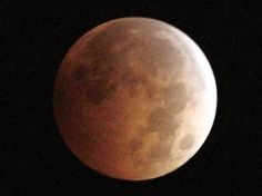 """An Oct. 8, 2014, photo shows the blood moon, created by the full moon passing into the shadow of Earth during a total lunar eclipse, as seen from Monterey Park, Calif. Sky-watchers will get a chance to see another """"blood moon"""" eclipse on Sunday."""