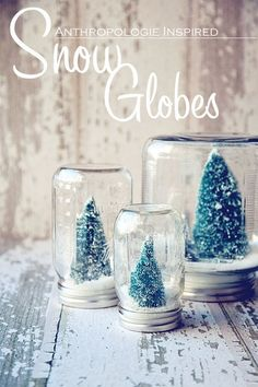 DIY Snow Globes! Super cute and easy! Perfect Christmas decoration! 1.Take a clear jar 2.Fill the jar with some white sand or anything that would look like snow 3.Glue a small tree decor (this could also could be santa) 4. Cover the lid