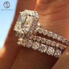 This 1.50ct radiant cut diamond engagement ring looks fantastic stacked with 2 wedding bands!