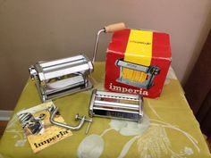 Vintage Imperia SP 150 Italian Pasta Manual Press Machine    Made in Italy    Made out of stainless steel with a wooden handle    Can make three