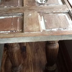 Repurpose old wood door and table legs for a sofa table