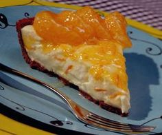 Guiltless Fresh Tangerine Cheesecake Recipe -- This is absolutely delicious and guilt free! Guiltless Fresh Tangerine Cheesecake is creamy and rich with the sweet taste of tangerines. It can't be beat!