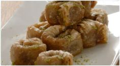 Saraglakia with walnuts and pistachios Greek Sweets, Greek Desserts, Greek Recipes, Pastry Recipes, Dessert Recipes, Cooking Recipes, Healthy Recipes, Cypriot Food, Greek Pastries