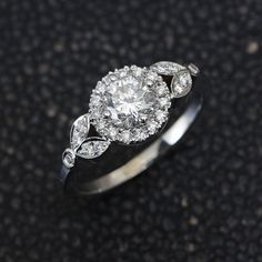 Unique diamond engagement ring - Roman crown inspiried beautiful, with leaves details from both side of the halo of the center diamond.  ♥ Center diamond: 0.2ct - 0.5ct, G-H color, Si1-Si2 clarity. ♥ Side diamonds total weight is minimum 0.15ct - 0.20ct (!) GVS quality ♥ Choose your diamond size, all diamonds are 100% conflict free natural diamonds. ♥ Each piece is specially and passionately created for you, choose your ring size, gold color and purity (14K / 18K / White Gold / Yellow Gold…