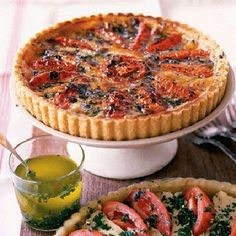 Tomato And Camembert Tart:  A flaky pastry crust plays host to sliced plum tomatoes in this show-stopping savory tart that will really wow your guests. - Delish.com