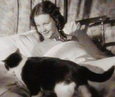 Half a century earlier then the photo taken at Tickerage Mill. Vivien Leigh in the film Sidewalks of London aka St. Martin's Lane. So fresh, young, and pretty. Her face always lit up around kitty cats.