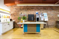 Hey! Offices of The Bold Italic. Modern, Natural Wood, Teal, Pallet desks ... tell me more!