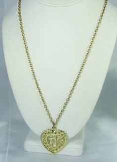 30% off sale until 11/23/15 A unique #vintage #necklace with #heart shaped pendant centered by Oriental symbol.  This necklace is so beautiful having a long gold tone metal chain which suspends a lovely ... #judysgems2 #gold #chain #pendant #oriental #teamlove #life