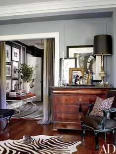 A doorway is framed by Restoration Hardware linen curtains customized with a border from M&J Trimming | http://archdigest.com