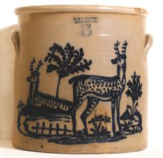 This fine and rare cobalt blue decorated, salt glazed stoneware 6-gallon crock with two large deer, signed by J Norton, Bennington, Vt., circa 1865, was sold to collectors Jerry and Susan Lauren for $90,000.
