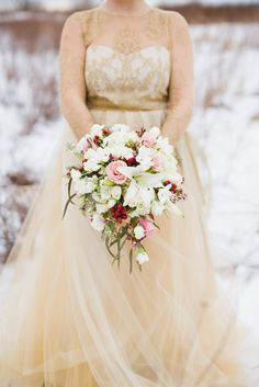 Romantic bridal bouquet in cascade form featuring, spray stock, hypericum berries, spray roses, roses, lilies and assorted accent flowers and greenery created by the designers at Sunnycrest Flowers.  #romanticbouquet #cascadebouquets
