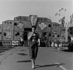 This photo of Gypsy Rose Lee was taken in 1949 at the Cotton Festival. The carnival in the back ground is the Royal American. Gypsy struts her stuff on the show bally platform at the far end of the midway along with the other burlesque performers. Gypsy received a salary of five thousand a week. The only other burlesque dancer that was paid this amount was Sally Rand.