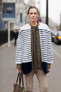 Navy and white stripes enliven this model's off-duty outfit.