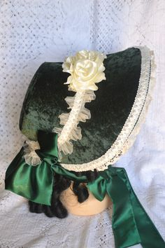 Beautiful crushed velvet dark green Victorian bonnet.                                                                                                                                                                                 More