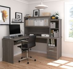 This premium L-shaped desk from Bestar comes in a smooth bark gray finish with silver handles and frosted glass hutch doors that combine for an elegant look. The return can go on either side,whichever