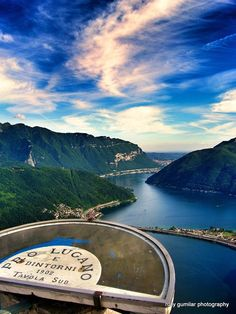 Lugano, Switzerland. I've stood right here! It's this peak that you can climb up or take a tram up to where, on top of the little church above the restaurant, there's a viewing deck to see Lugano in all directions. Amazing.