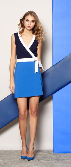 Wrap yourself in ultra-modern magnificence by DVF, featuring the Gracie Colorblocked Wrap Dress.