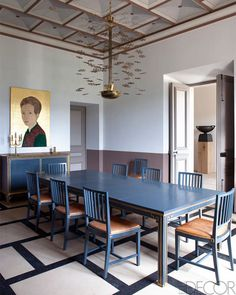 the light fixture is by Paavo Tynell, and the carved-wood and painted portrait is by Stephan Balkenhol.