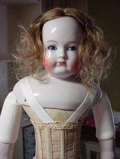 "Circa 1855 Blampoix Sr. french fashion doll.  21.5"" tall, German leather body, human hair wig."