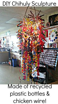 Chihuly sculpture made of plastic bottles, chicken wire, and christmas lights. This sculpture has over 200 plastic bottles painted with acrylic paint and cut into interesting shapes. Excellent collaborative art project for middle school students!