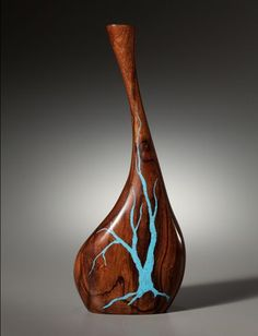 Ironwood with Turquoise inlay by Larry Favorite.