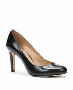"Beautifully crafted in rich leather, our forever stylish pumps are a definitive wardrobe essential. Round toe. Padded footbed for complete comfort. Covered 3 1/4"" heel."