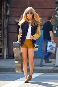 Taylor Swift wears a varsity jacket.