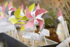 Pinwheel centerpieces would make for lovely decorations at your Picnic Party! For more party ideas visit YouCanPlanAParty.com