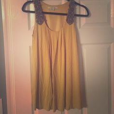 Forever 21 long tank top dress with beading Forever 21 mustard yellow tank shirt dress. Pretty grey beading on the straps. This is long enough to cover your bottom so you can wear with leggings, it is too short to wear nothing underneath but longer than a regular shirt. Size small Forever 21 Tops Tank Tops