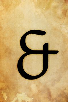 Ampersand on stained paper.