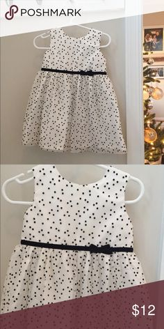 12 month Carter's holiday dress. Adorable white with black polka dot 12 month holiday dress. Fully lined with sheer outer shell. Three buttons in the back for putting on/taking off. Smoke free and pet-free home. **Check out my closet for other boy and girl size newborn - 3T clothes! I am in the process of selling off all of my boy/girl twins' clothes! If you are looking for something in particular, let me know, I most likely have it! ** Please let me know if you have any questions about…