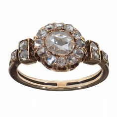 Trendy Diamond Rings : An antique Rose-Cut Diamond Cluster Ring Of a cluster design to a carved gallery