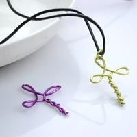 This colorful wire wrapped cross and black leather cord necklace come together to create an easy metal jewelry tutorial. It is an easy-to-learn way to craft a DIY cross necklace for girls.